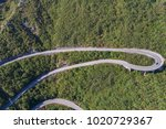 aerial view on road serpentine... | Shutterstock . vector #1020729367