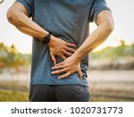 back pain  close up young man... | Shutterstock . vector #1020731773