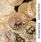 bitcoin on wooden table top | Shutterstock . vector #1020734323