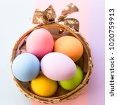 Small photo of top view pastel Easter egg on paster pink colour background.Colorful Easter eggs are used on Easter every year.