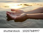 woman hands in water inviting... | Shutterstock . vector #1020768997
