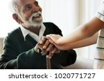 grandson holding grandpa's hands | Shutterstock . vector #1020771727
