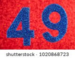 Small photo of Number forty-nine blue color over a red background. Anniversary. Horizontal