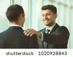 the happy men pat on the... | Shutterstock . vector #1020928843