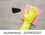 hand in yellow protective...   Shutterstock . vector #1020931537