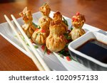 portion of six fried wontons on ...   Shutterstock . vector #1020957133