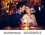 romantic couple dating in pub... | Shutterstock . vector #1021036513