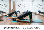 side view of sporty women doing ... | Shutterstock . vector #1021037293