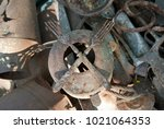 rusty dishes lie a bunch. two... | Shutterstock . vector #1021064353