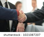 partners concluding deal and... | Shutterstock . vector #1021087207