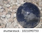 glass ball with clouds in...   Shutterstock . vector #1021090753