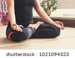 woman makes the yoga exercise... | Shutterstock . vector #1021094323