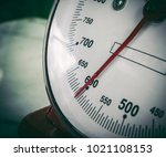 Small photo of A kilogram of scales on a white background with paths and numbers.