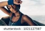 close up of tired female with... | Shutterstock . vector #1021127587