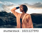 african woman standing with her ... | Shutterstock . vector #1021127593