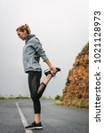fitness woman doing stretching... | Shutterstock . vector #1021128973