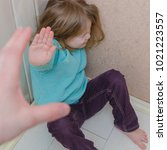 a child hides in the corner of...   Shutterstock . vector #1021223557