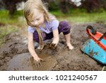 funny little girl playing in a... | Shutterstock . vector #1021240567