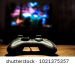 Small photo of isolated gamepad video game controller on the table