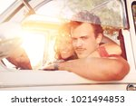 young couple in a retro car  at ... | Shutterstock . vector #1021494853