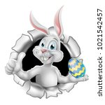 easter bunny rabbit breaking... | Shutterstock .eps vector #1021542457