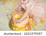 Small photo of little girl smash the cake