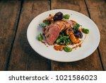 ros  duck breast with broccoli... | Shutterstock . vector #1021586023