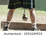 scottish person with kilt and... | Shutterstock . vector #1021634923