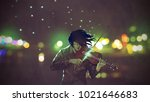man playing magic violin in a... | Shutterstock . vector #1021646683