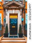 entrance door without logos in... | Shutterstock . vector #1021652497