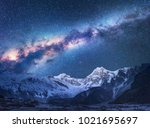 space. milky way and mountains. ... | Shutterstock . vector #1021695697