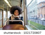 beautiful woman driving on a... | Shutterstock . vector #1021720807