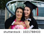 young beautiful woman graduate... | Shutterstock . vector #1021788433