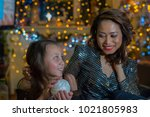 mother and daughter in the home ...   Shutterstock . vector #1021805983