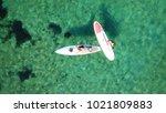 windsurf in tropical beach   Shutterstock . vector #1021809883