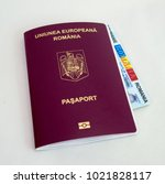 Small photo of A biometric romanian passport and a national ID card.