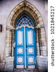 Small photo of TALLINN, ESTONIA - February 2018: Old wooden blue door with beautiful decoration at Old Town Tallinn, Estonia