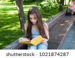 cute teenage girl reading book... | Shutterstock . vector #1021874287