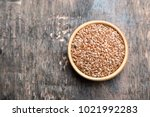close up of flax seeds on dark... | Shutterstock . vector #1021992283
