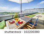 Apartment building roof top terrace exterior with fresh breakfast - stock photo