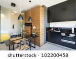 Modern interior design with kitchen and table - stock photo