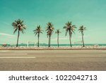 sunny day with palms on ipanema ... | Shutterstock . vector #1022042713