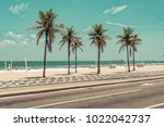 sunny day with palms on ipanema ... | Shutterstock . vector #1022042737