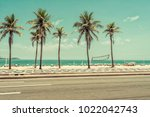 sunny day with palms on ipanema ... | Shutterstock . vector #1022042743