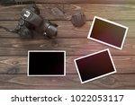 photos  a camera on the...   Shutterstock . vector #1022053117
