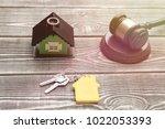 house. hammer of a judge  keys...   Shutterstock . vector #1022053393
