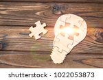 wooden lamp from puzzles on a...   Shutterstock . vector #1022053873