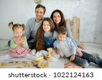 day off in a big family. dad ... | Shutterstock . vector #1022124163