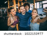 friends having fun at the gym.... | Shutterstock . vector #1022153977