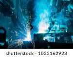 robot is welding metal part in... | Shutterstock . vector #1022162923